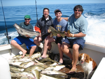 Dave, Dave, Robert and Benjamin reeld up a literal boatload of fish aboard Tuna Hunter Fishing Charters