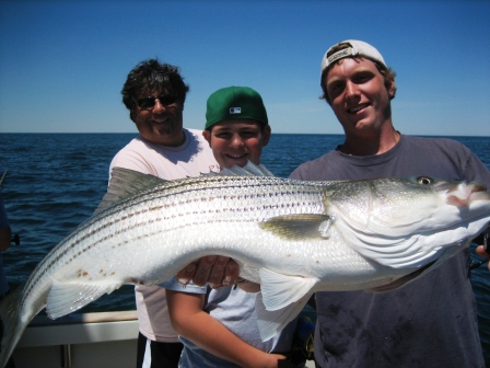 Dave Rubin and son Benjamin landed this whale of a striper, amoung others, on a June Tuna Hunter charter.